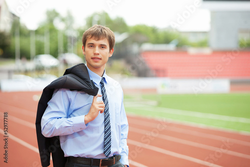 Businessman at athletic stadium and race track