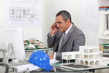 real estate businessman working in his office