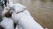 Überflutung und Sandsäcke