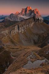 Last sunrays touch the mountain peak