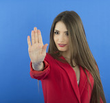 Woman smiling and showing his hand in signal of stop