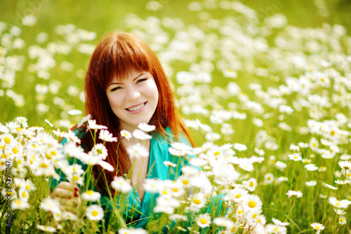 redhead  young woman in the feild