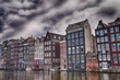 Amsterdam. Wonderful view of city canals and buildings in spring
