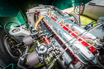 engine bay of a powerful vintage automobile