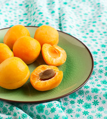Fresh apricots in green plate