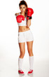 Pretty young woman punching with red boxing gloves