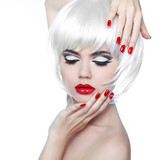 Makeup and Hairstyle. Red Lips and Manicured Nails. Fashion Beau