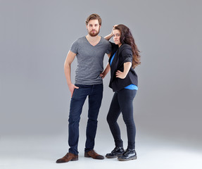 Young couple on grey background