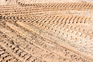 Tire tracks prints in sand