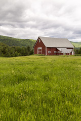 Farm landscape with red barn and pasture land