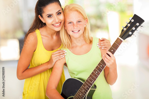preteen girl with her music teacher