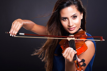 attractive woman playing violin
