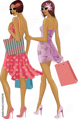 Two chic young women with shopping bags over white background.