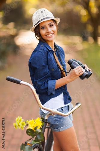 happy woman with binoculars outdoors