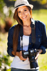 pretty woman with a camera outdoors