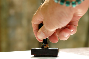 Hand and rubber stamp