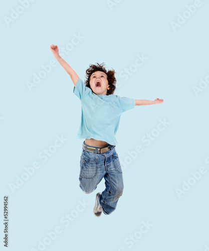 Adorable child jumping