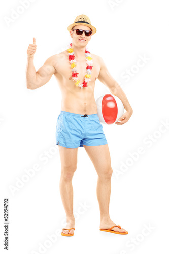 Full length portrait of a male in swimming shorts, holding a bea