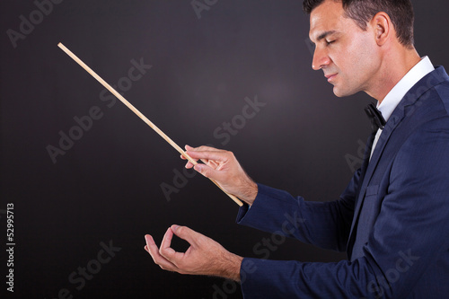 music conductor with eyes closed