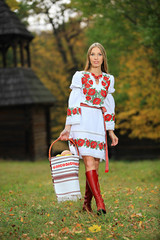 Portrait of beautiful young woman in Ukrainian style clothing