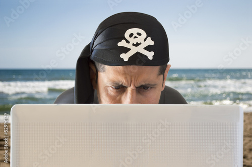 hacker  looking confused on the beach