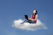 Beautiful female sit on cloud using laptop