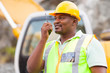 afro american industrial worker talking on walkie-talkie