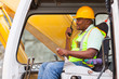 african industrial worker operating bulldozer