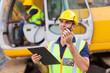 construction foreman talking on walkie-talkie