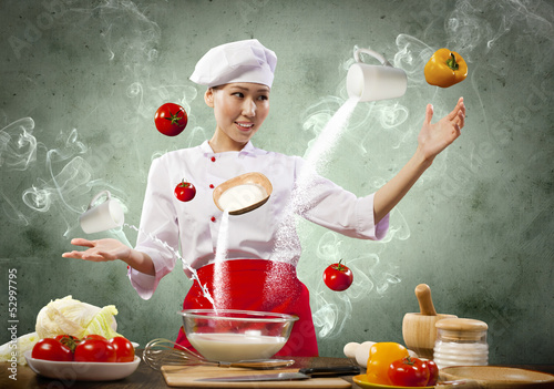 Asian female cooking with magic