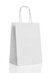 White paper shopping bag isolated.