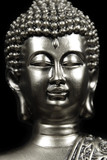silver Buddha head on black background