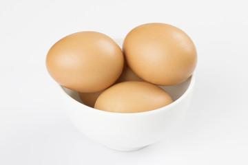 Boiled eggs in white bowl