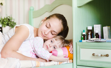 mother and sick daughter sleep together