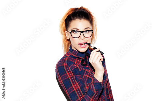 Portrait of a girl with a nerdy look smoking