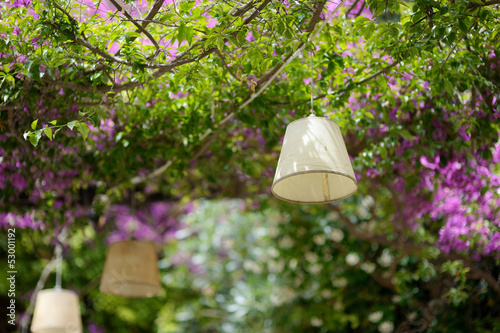 A lamp hanging above summer outdoor cafe