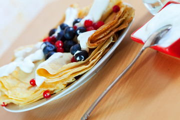 Pancakes with berries and cream