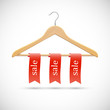 Sale concept - wooden hangers  with red ribbons