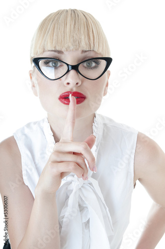 Smart  businesswoman making silence sign over white background.
