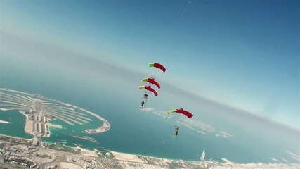Skydiving. a group of paratroopers perform sporty element