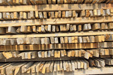 stacked together wood on a building site