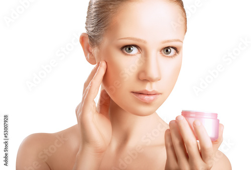 skin care.  beauty healthy girl with jar of cream isolated on wh