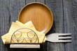 Empty plate on vintage boards with cutlery sign of food concept