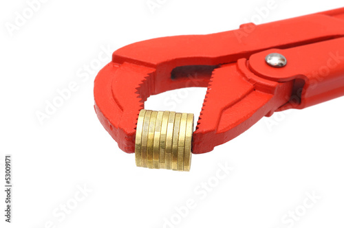 salary or income concept with pipe wrench and coins