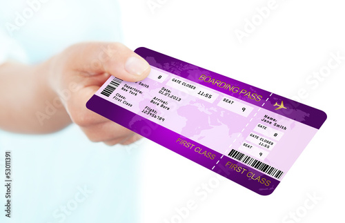 fly boarding pass ticket holded by hand over white background