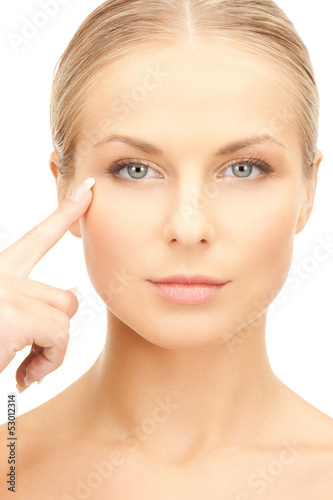 woman pointing at her eye area