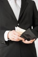 man with euro cash money