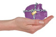 Locked piggy-bank in a hand