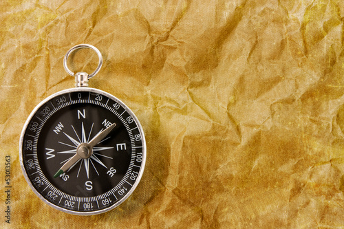 Compass on the grunge  background