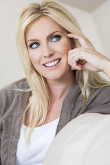 Blond Woman With Blue Eyes Smiling